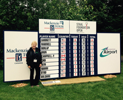 Leeanne Portelance (Thunder Bay mill) checks out the leaderboard for the tournament on Thursday morning.